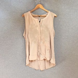 Beige sleeves button down top.